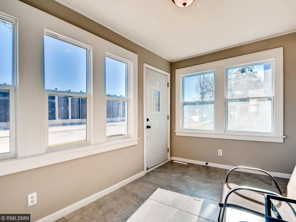 Four season porch features a new tile floor and windows on all four sides!Read the paper (on your tablet) in your new home this year at 4504 Stevens.
