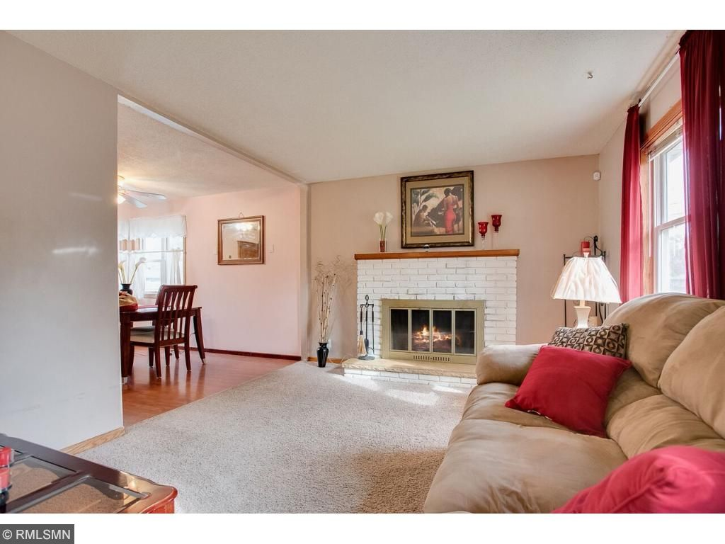 Inviting Living room with a fire place for those cold Minnesota winters.