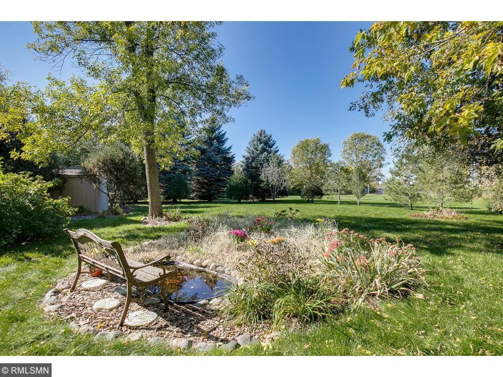 Relax and enjoy the view!! This sits on .54 acres and backs up to park land and walking trails for even more panoramic enjoyment!!!