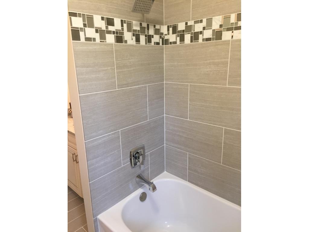 Main Level bathroom. Granite top, custom tile!