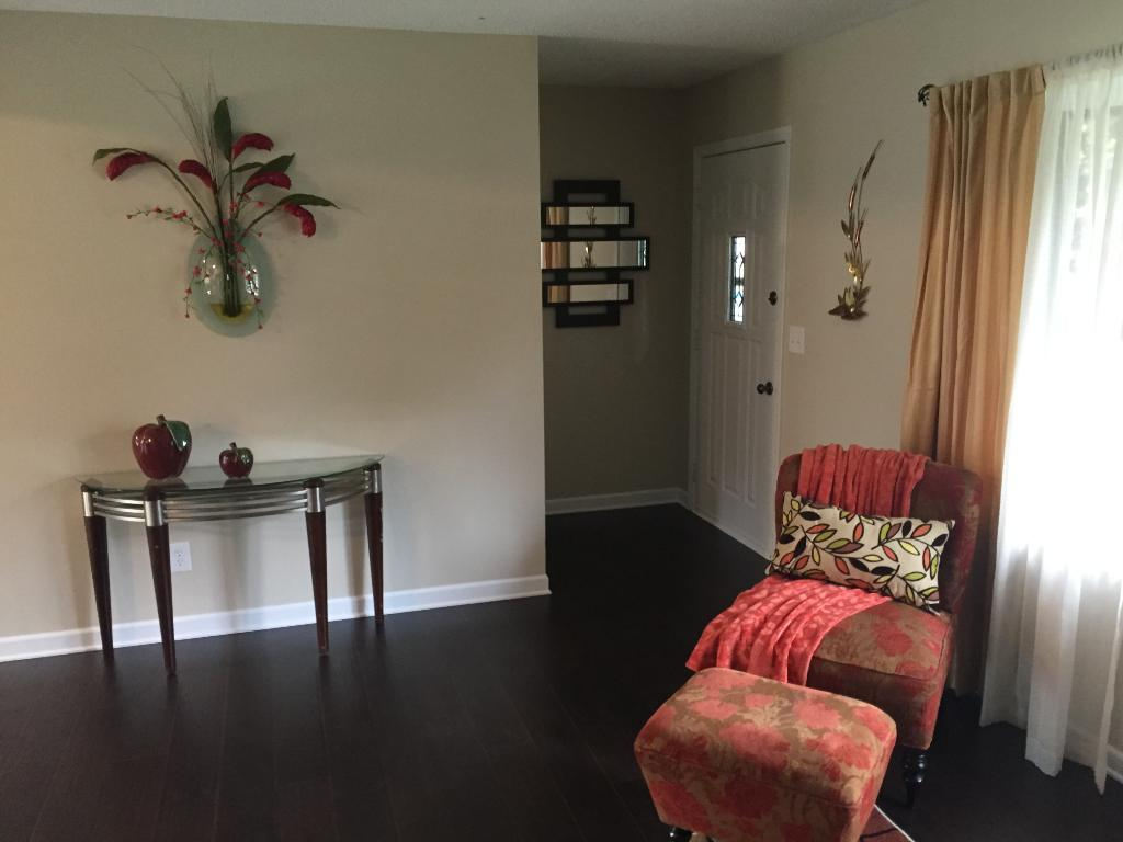 Living room has a bay window and very spacious. Notice new wood floors!