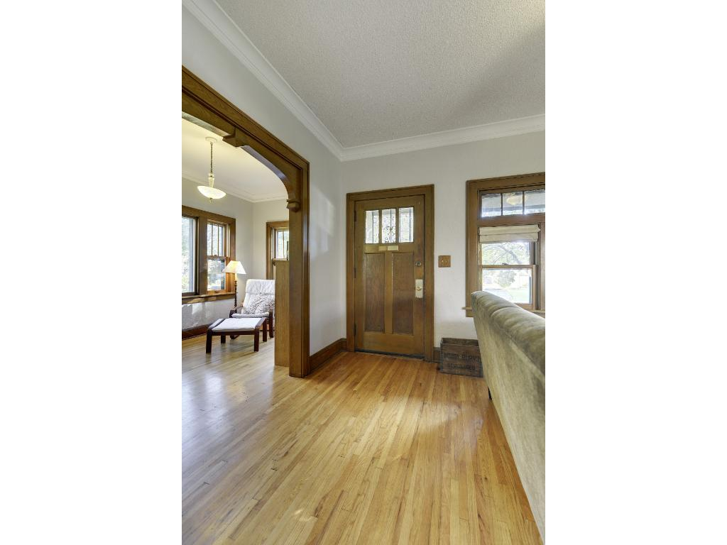 Beautiful natural oak woodwork and floors.  Sun drenched sitting room includes a hard-to-find coat closet in vintage homes.