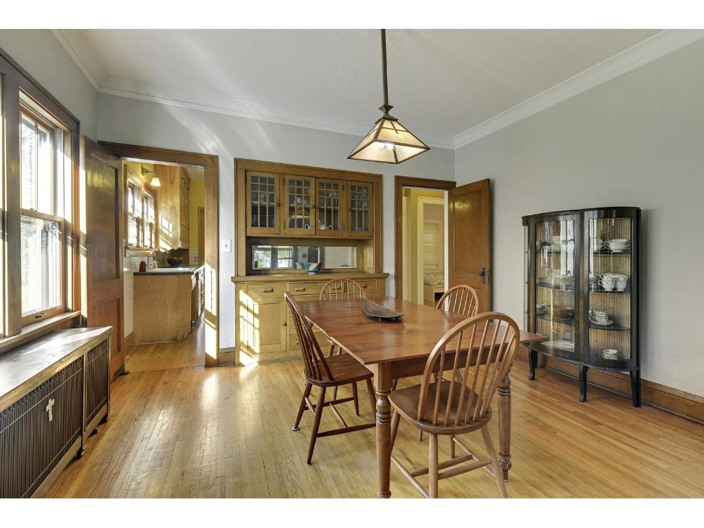 This sun drenched dining room enjoys the same quality architectural detail as the living room with the natural woodwork and coved ceiling.  Enjoy displaying your china or keepsakes in this built-in buffet.