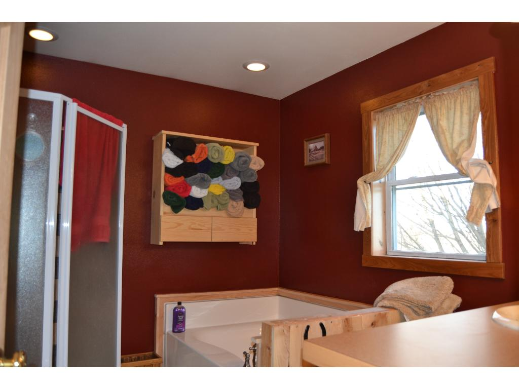 Upper level Full Bath with Soaking Tub and separate Shower.