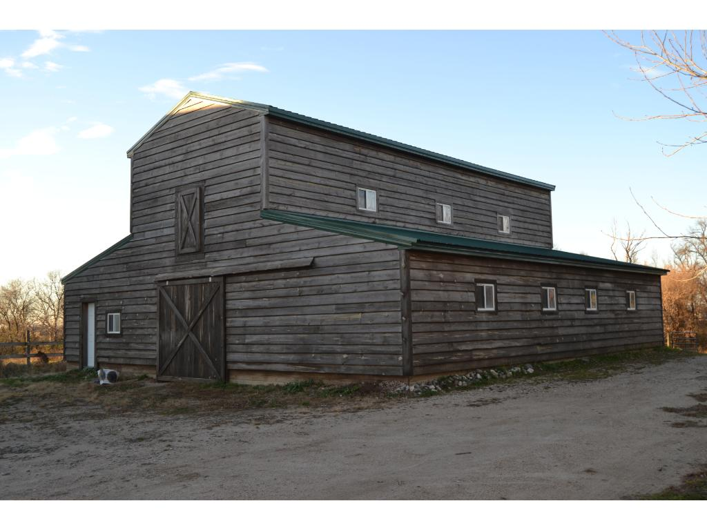 48x46 two story shed with 5 Box Stalls.