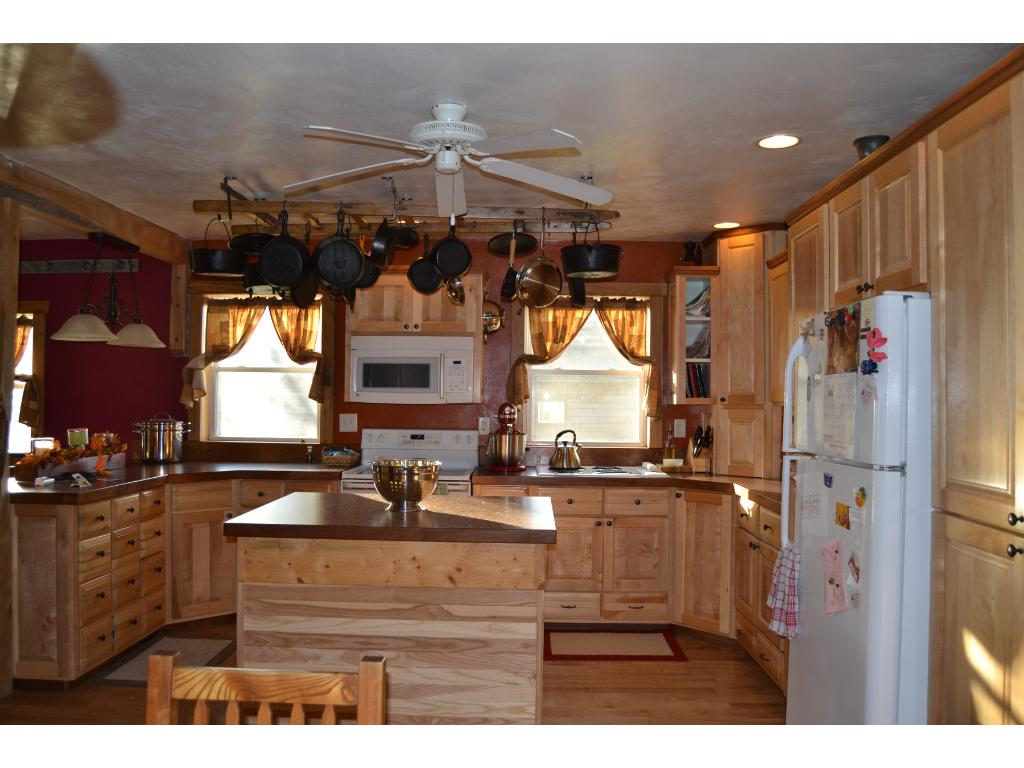 Kitchen with Custom Cabinets & Bakers Drawers on Real Hardwood.