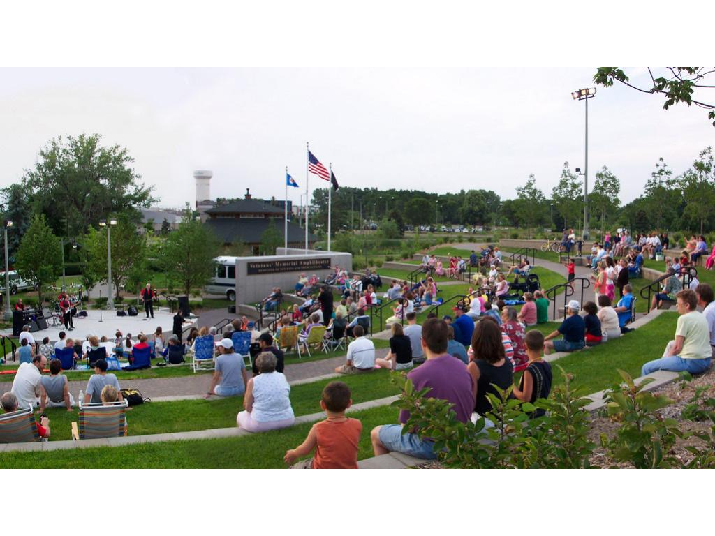 The Veterans' Memorial Amphitheater is terraced into the hill on the south side of Wolfe Park and connects the park to the Excelsior & Grand Town Green. Eight terraced tiers offer seating for 200 people with many free concerts throughout the summer.
