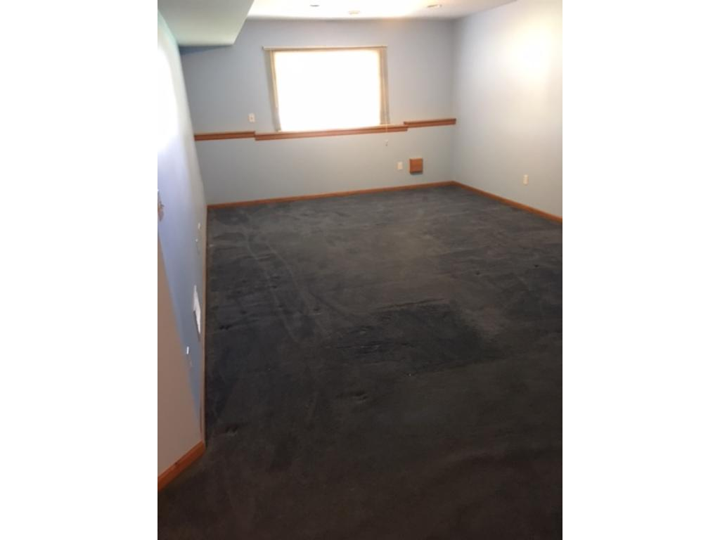 Lower level 4th Bedroom. Could also be a home business or office.