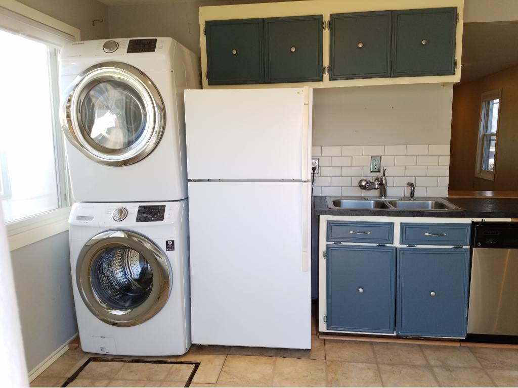 Lots of storage and even a main level laundry area including newer full sized stackable washer and dryer.