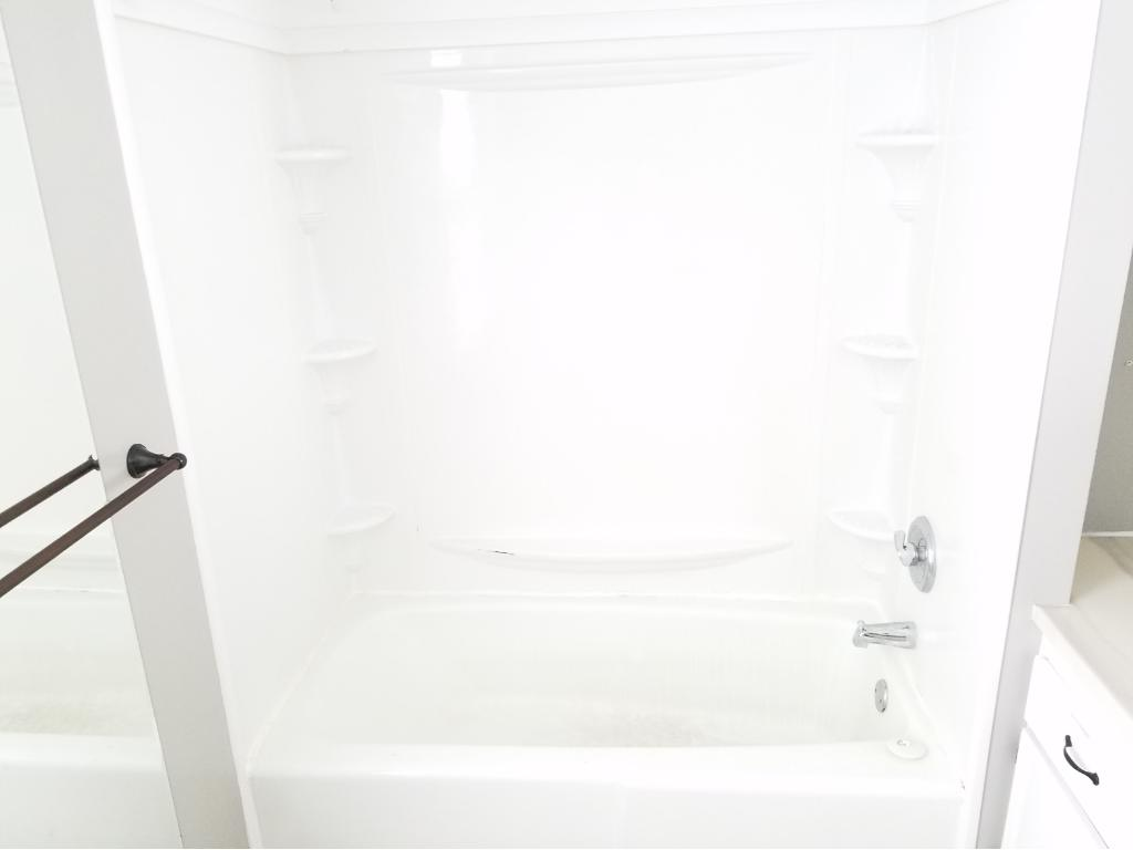 Newer tub and shower area.
