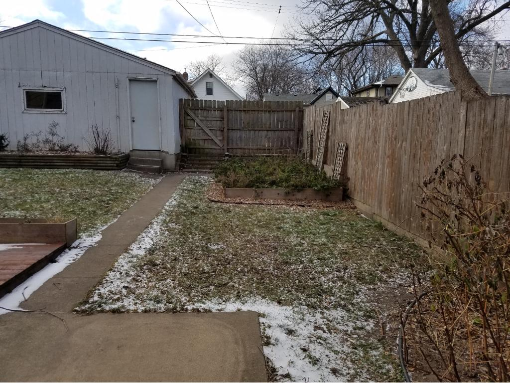 Fantastic backyard is privately fenced and includes gardens, potting shed and deck located right outside the kitchen.