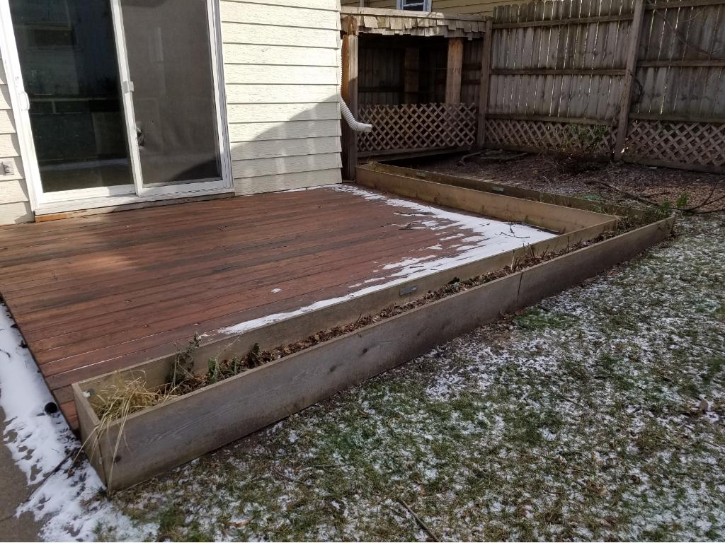 Level deck close to the ground providing easy access to the yard and garage.