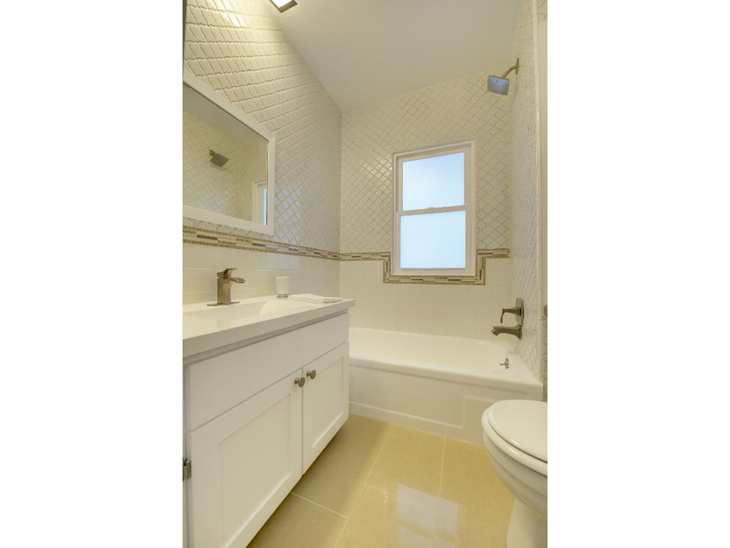 Amazing new bathroom with full tile surround.