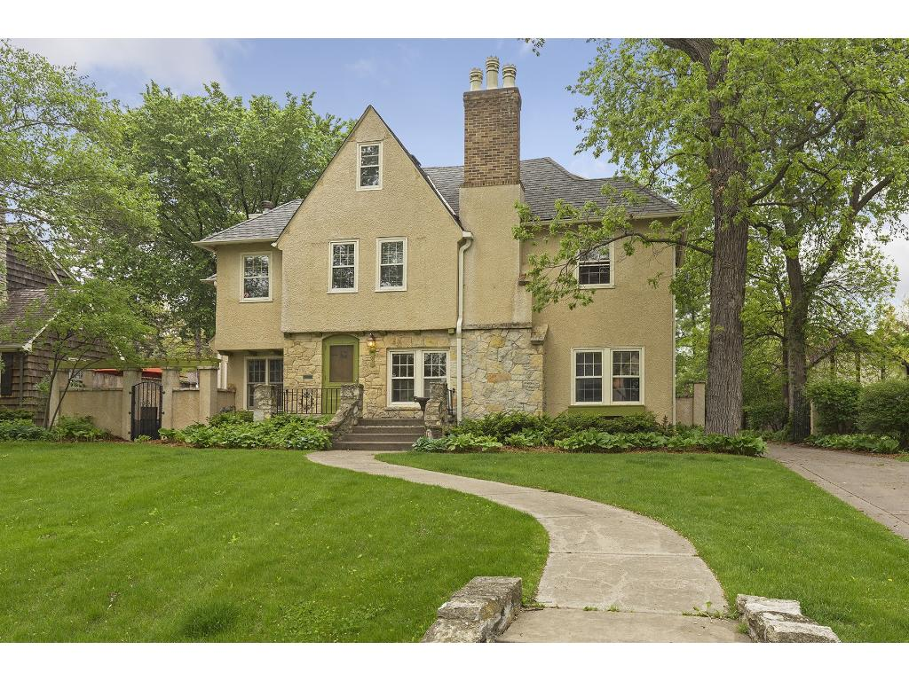 4602 Sunnyside Road - a delightful blend of historic Country Club and renovation on a picturesque street.