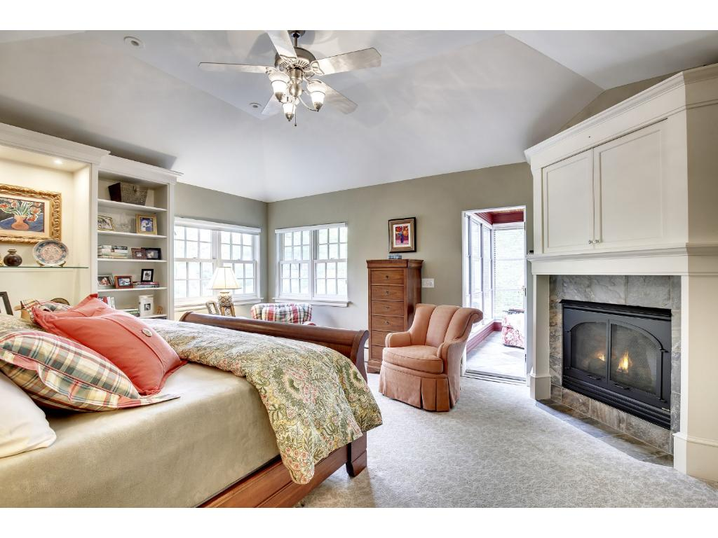 Owner's suite features a gas fireplace, a large walk-in closet, ample private bath with walk-in shower and separate bath, and sunroom.
