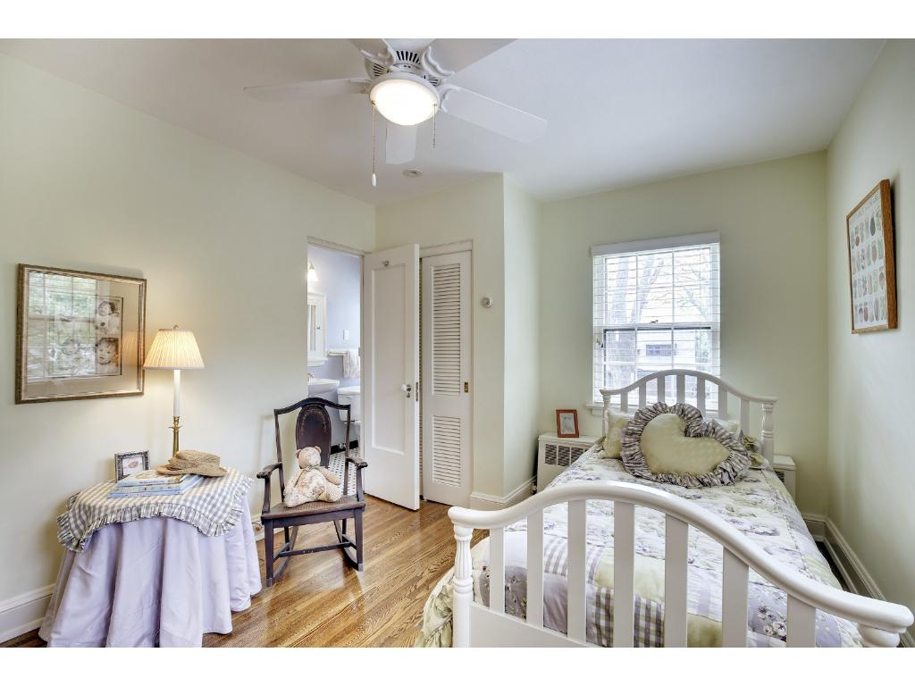 Second bedroom on the upper level has a 3/4 ensuite bath with charming original tile.