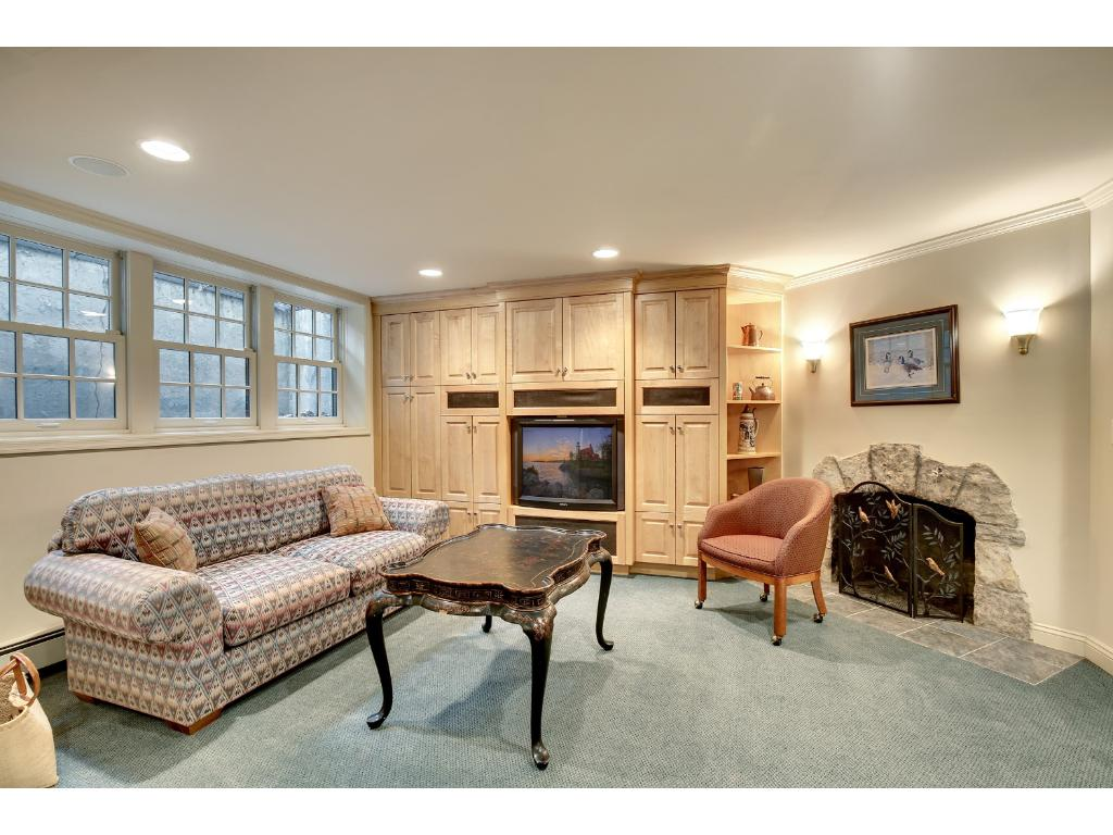 Finished lower level includes large amusement room with fireplace, playroom area, second laundry room and powder bath.