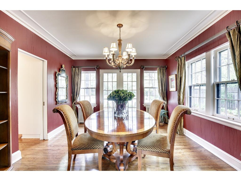 Formal dining room features French doors that lead to the back patio for summer entertaining.