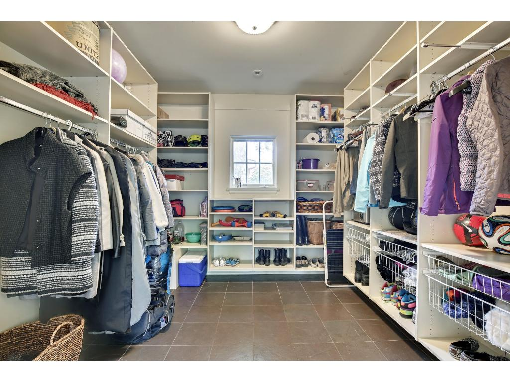 Oversized mudroom just off the three car garage, with plenty of built-ins for coats, supplies and equipment.