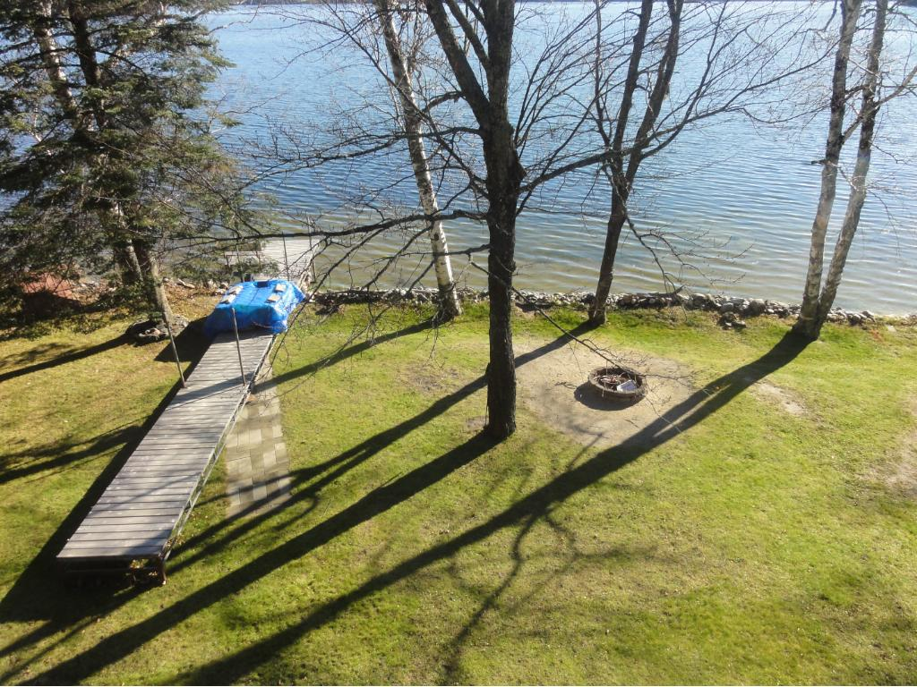 Gradual Elevation to sandy beach w roll out dock and outbuilding w sauna!