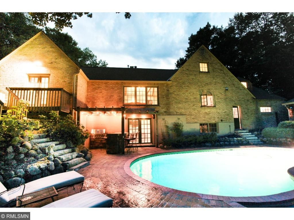 Pool area overlooks the 2.5 acres of complete privacy.  Pool area features a concrete pool in wonderful condition, brick paver pool deck and outdoor kitchen and bar area and a small pool house/shed for storage