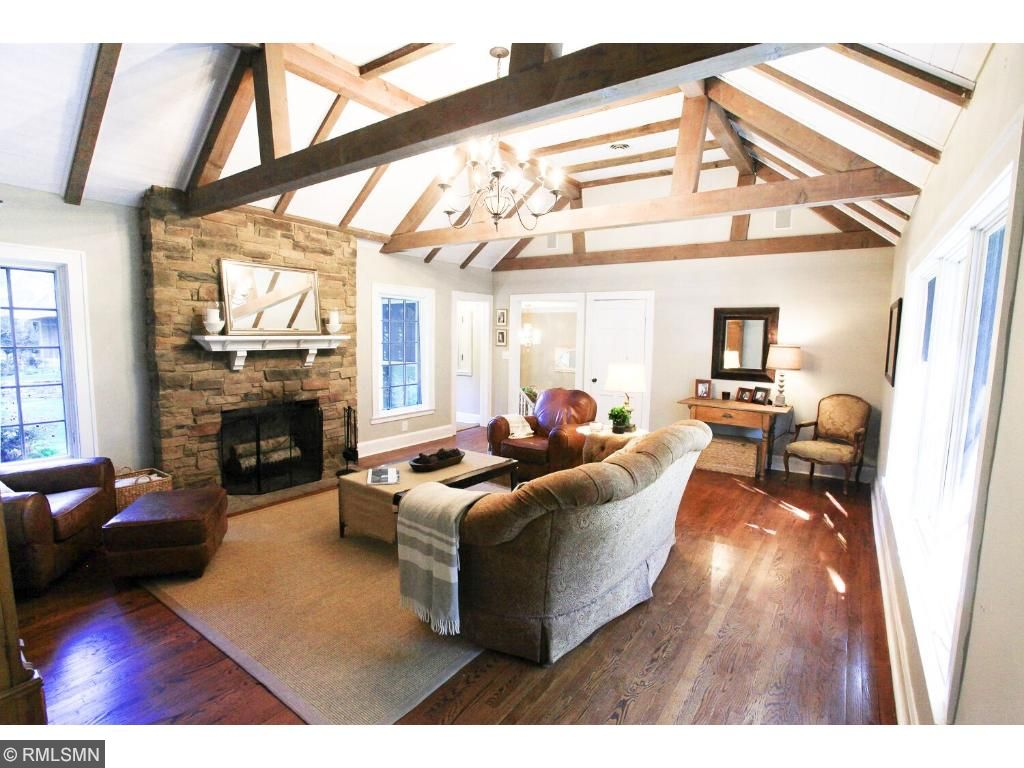 Vaulted beamed great room with large windows make this a light-filled space all day long.