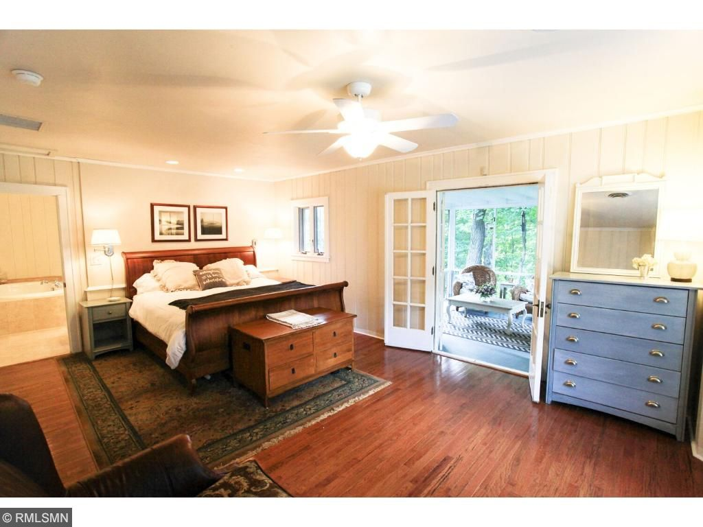Spacious master featuring wood floors, bay window with window seat, private screen porch and large updated master bath with large soaking tub, shower and double sinks