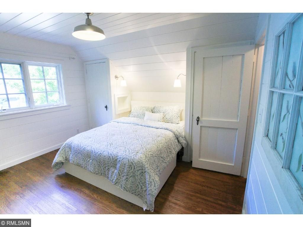 Wood planked upper level bedroom.  This one has a built in nook area for the bed with lighting.