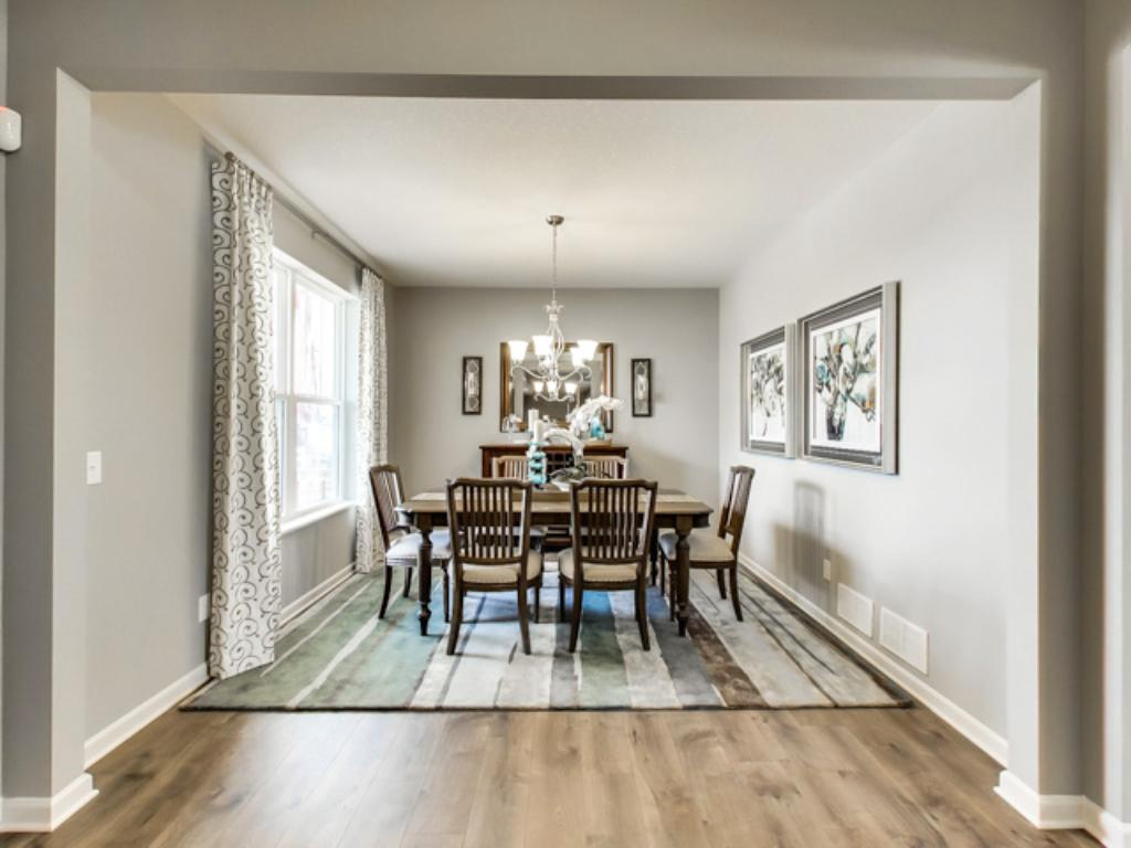 Floor plan flexibility is highlighted with this room, which can serve as a formal dining area (as shown), another sitting room, a toy room for the little ones, or just about anything else you can think of! (Photo of model, finishes will vary)