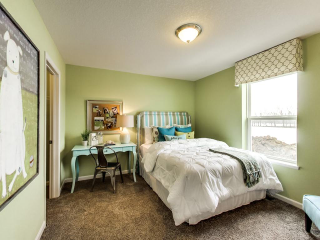 Each of the home's three secondary bedrooms on the upper level come perfectly sized, and each also feature their own private walk-in closet.