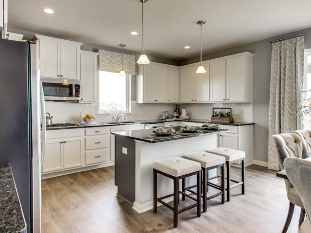 Well appointed with an undervalued combo of functionality and beauty, the  kitchen space is sure to impress.  (Photo of model, finishes will vary)