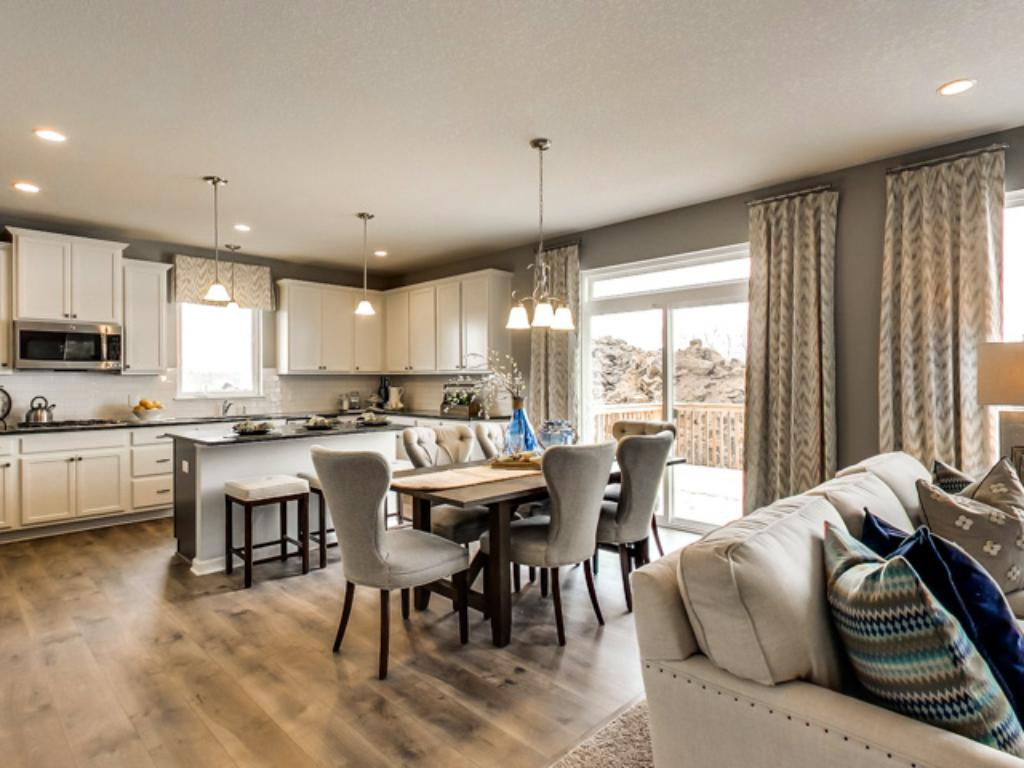 The main level space seamlessly transition from room to room, providing each some individual definition while maintaining that open concept throughout. (Photo of model, finishes will vary)