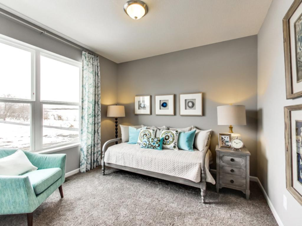 The Jordan features a rare main level BR to provide your guests some nice space on the main floor, complete with a spacious 3/4 bath just outside the bedroom. This could also double as a home office, if needed. (Photo of model, finishes will vary)