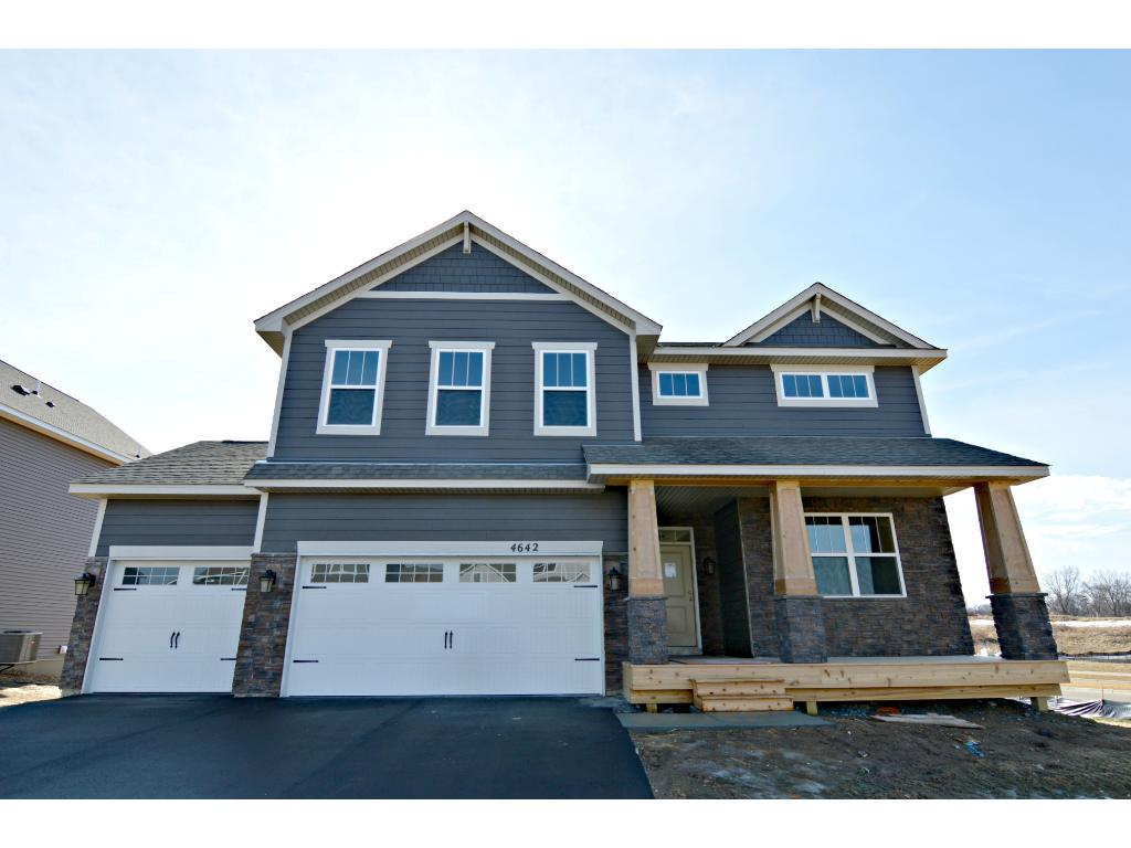 An absolute stunner from the curb, the home's Craftsman style elevation comes with a covered and spacious front porch!