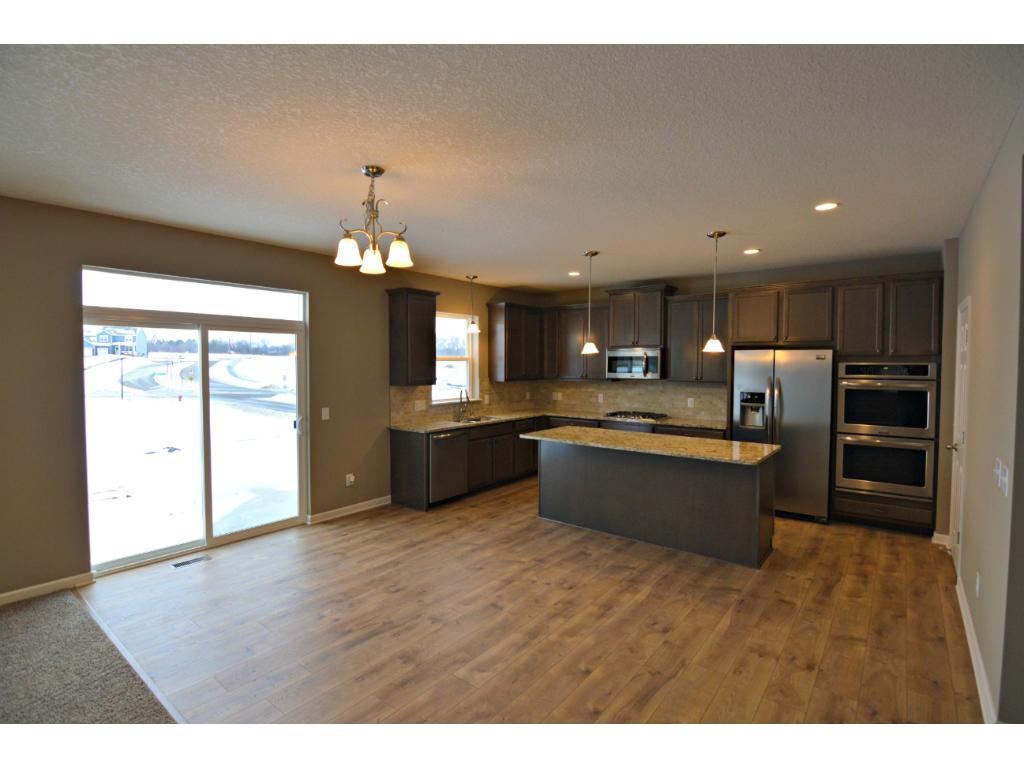 Just off the kitchen space resides an informal dinette large enough for any family. Photo of model, finishes will vary.