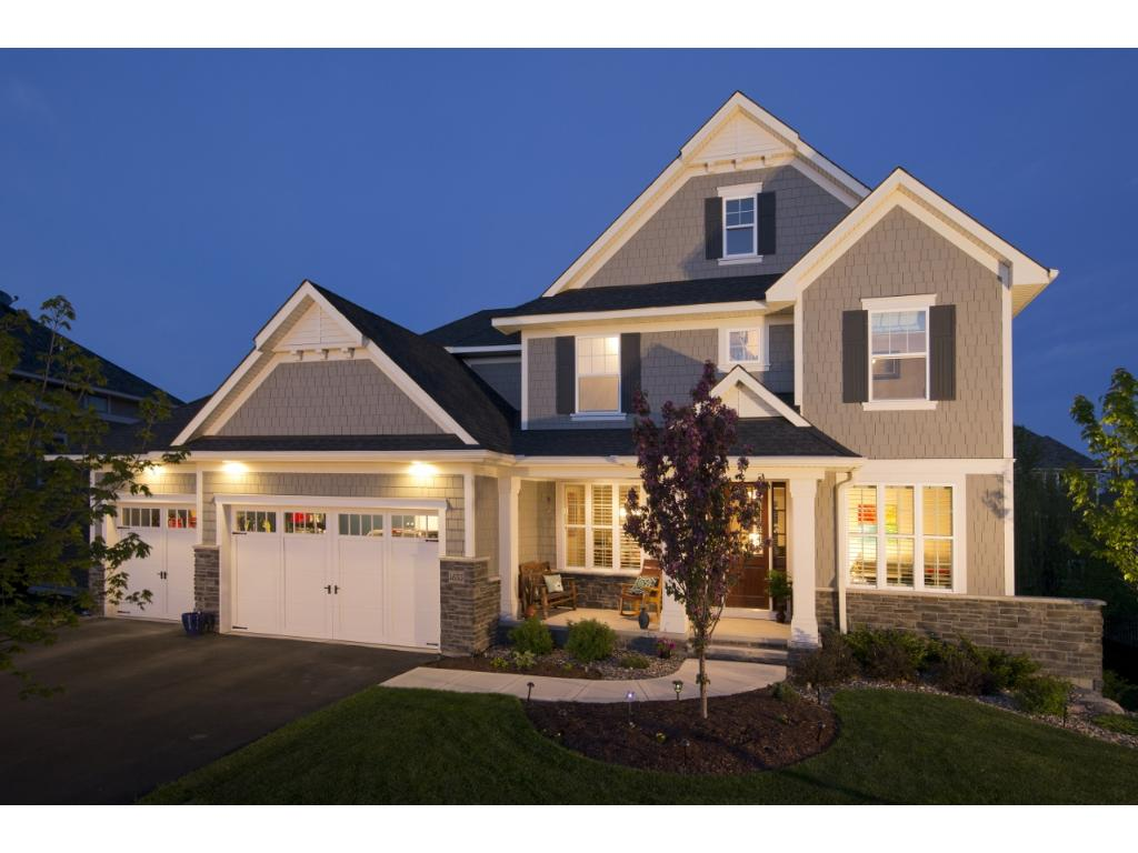 Stunning executive two story on a prime lot in coveted Bridgewater at Lake Medina.