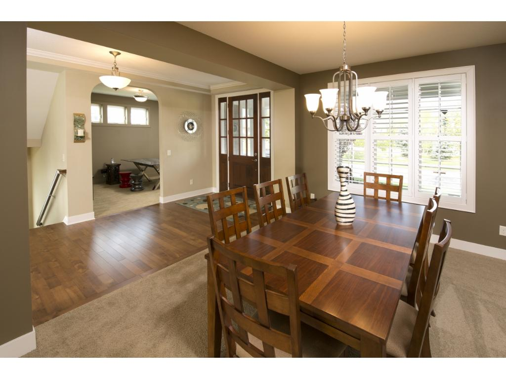 The large formal dining room can accommodate large tables and is the perfect gathering space for dinner parties.