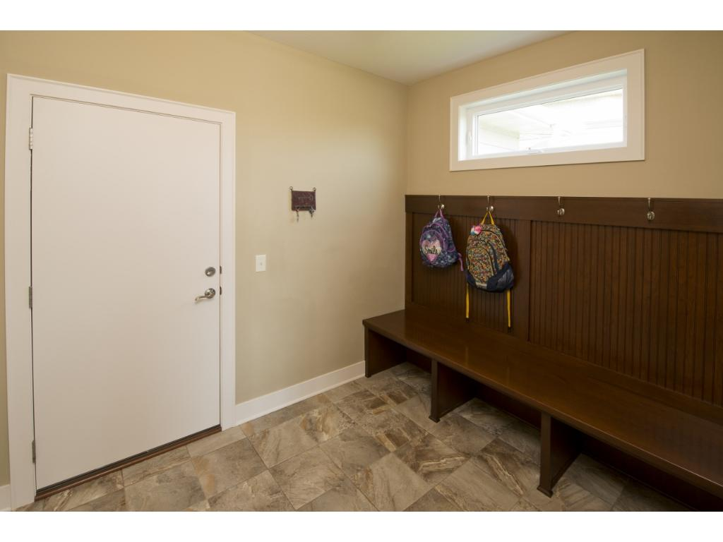 The mudroom features more built-in cabinetry as you enter from the garage.