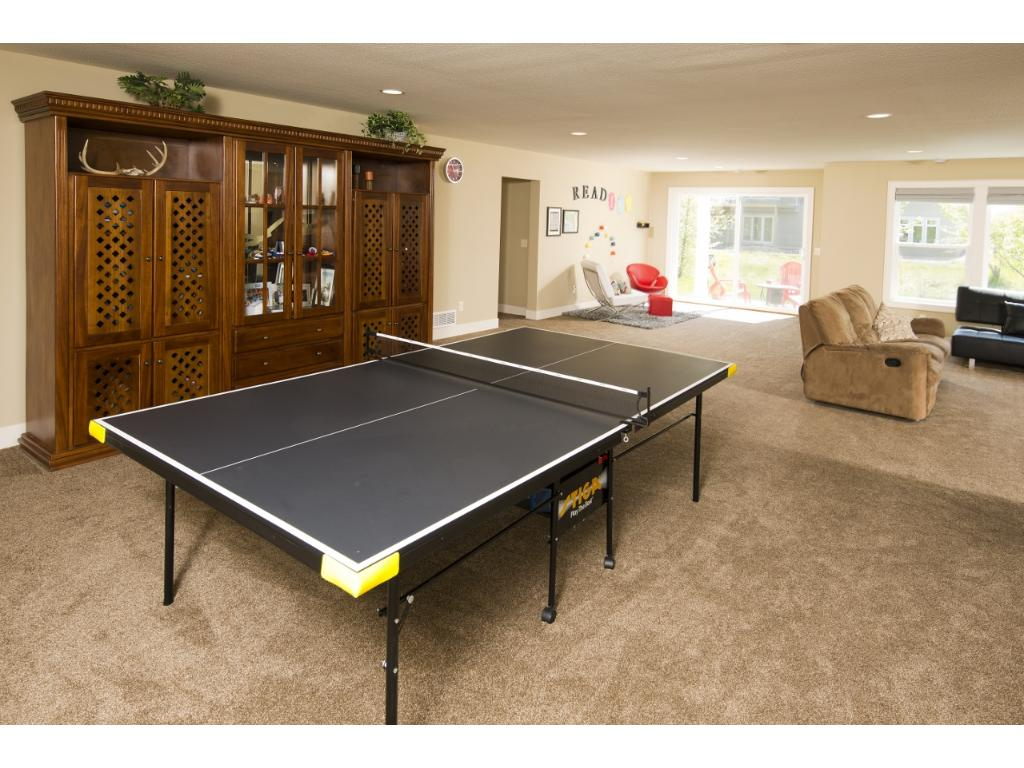 A game room is adjacent to the family room.