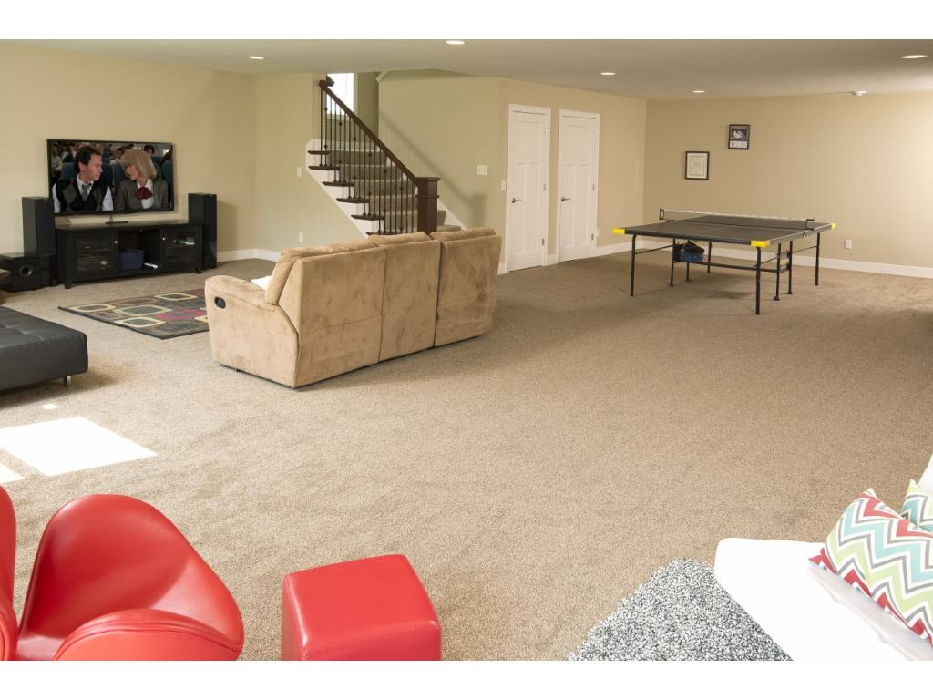 The walk-out lower level also features a 5th guest bedroom and an abundance of storage space.