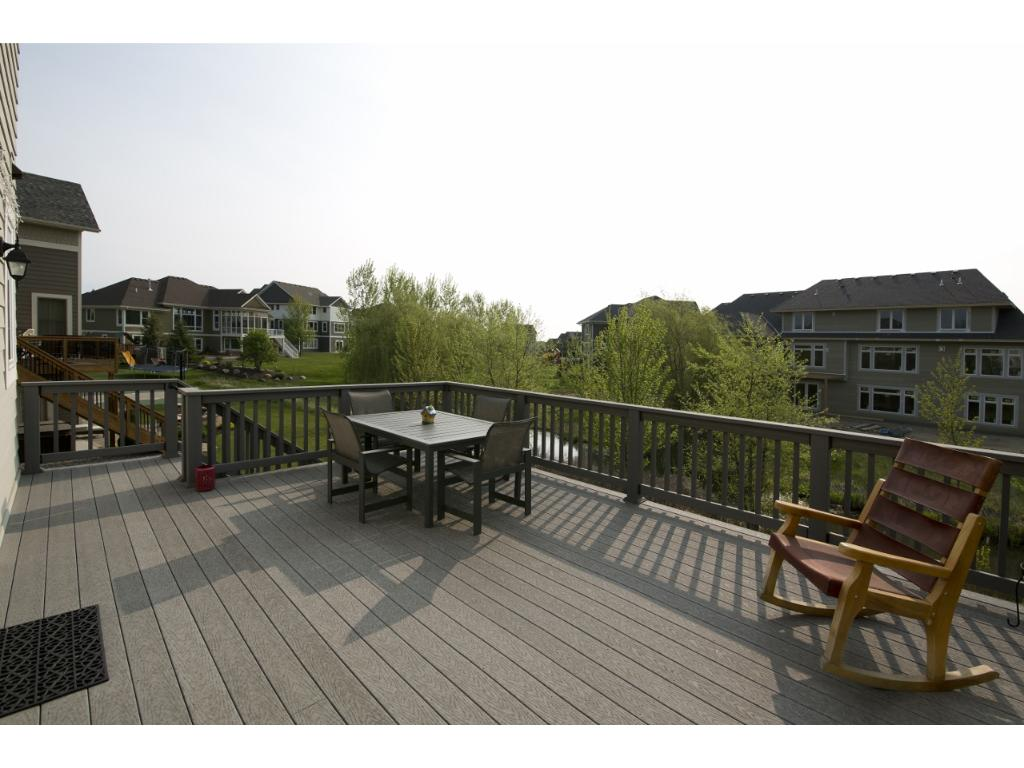 Relax on the spacious deck overlooking the backyard and pond.