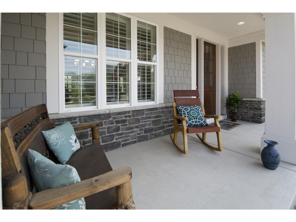 You are greeted by the covered front porch as you approach the home.