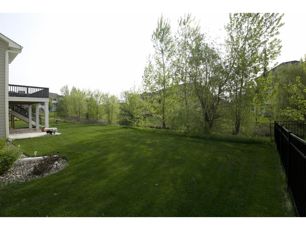 The flat back yard overlooks the neighborhood pond.