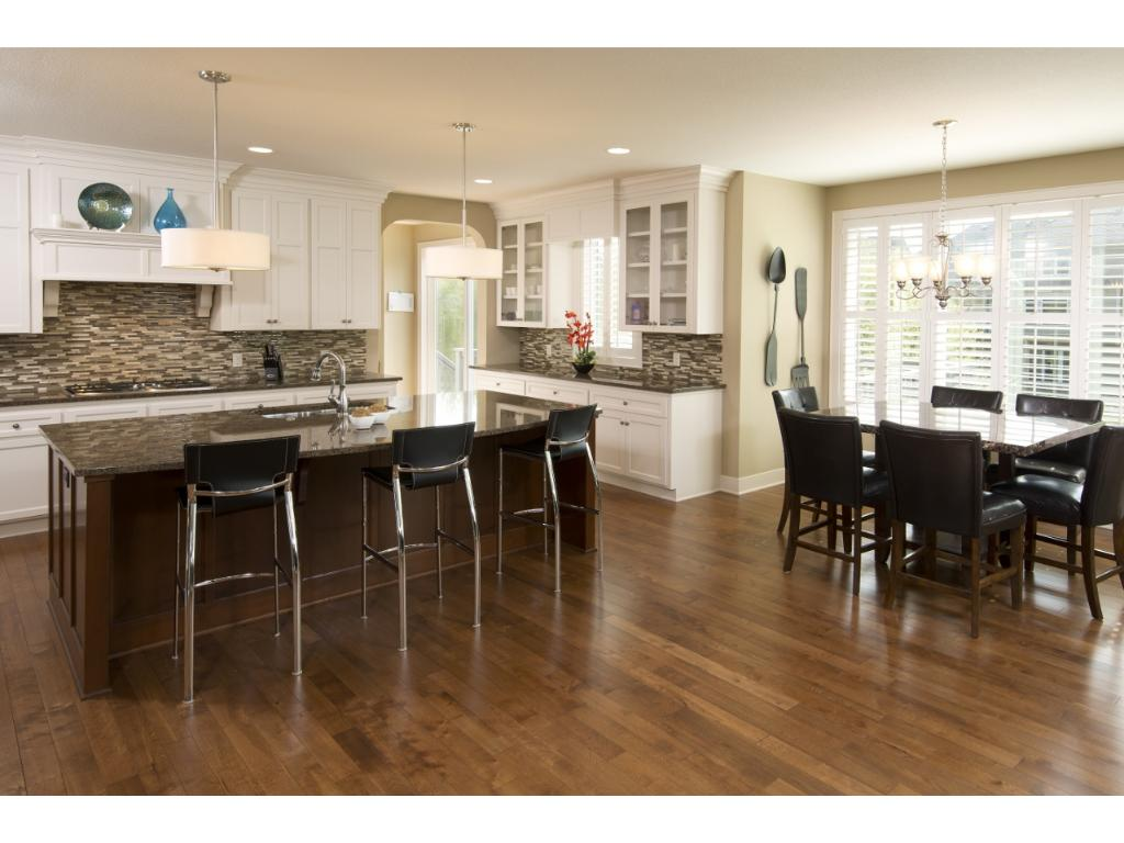 The open floor plan features a great room concept with a large center island kitchen.