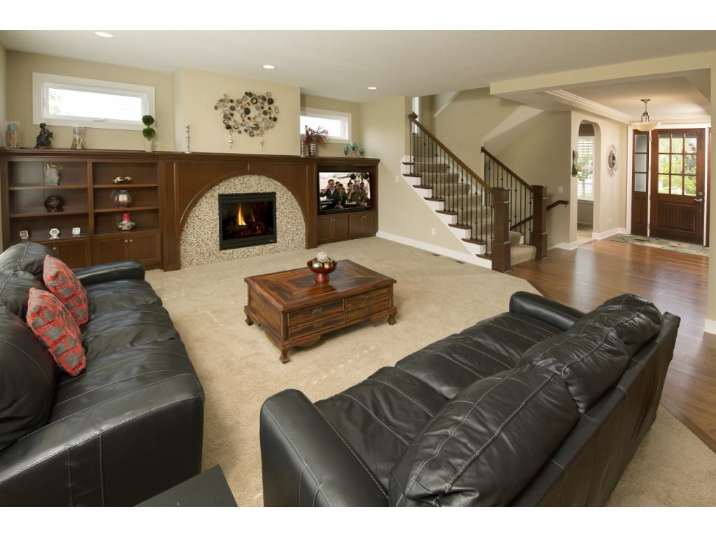 The great room is accented by built-in cabinetry surrounding the gas fireplace.