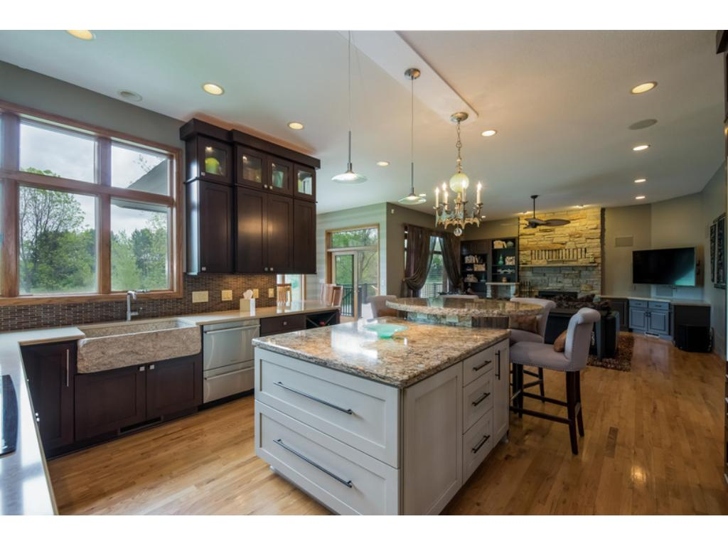 Stone Farmers kitchen sink, granite counter tops, stainless steel chefs appliances, and a chandelier. This Kitchen has it all