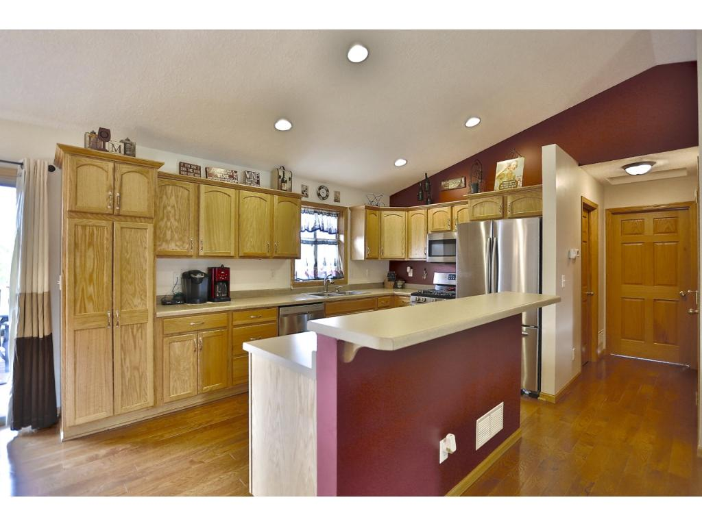 Oak cabinets and newer stainless steel appliances.