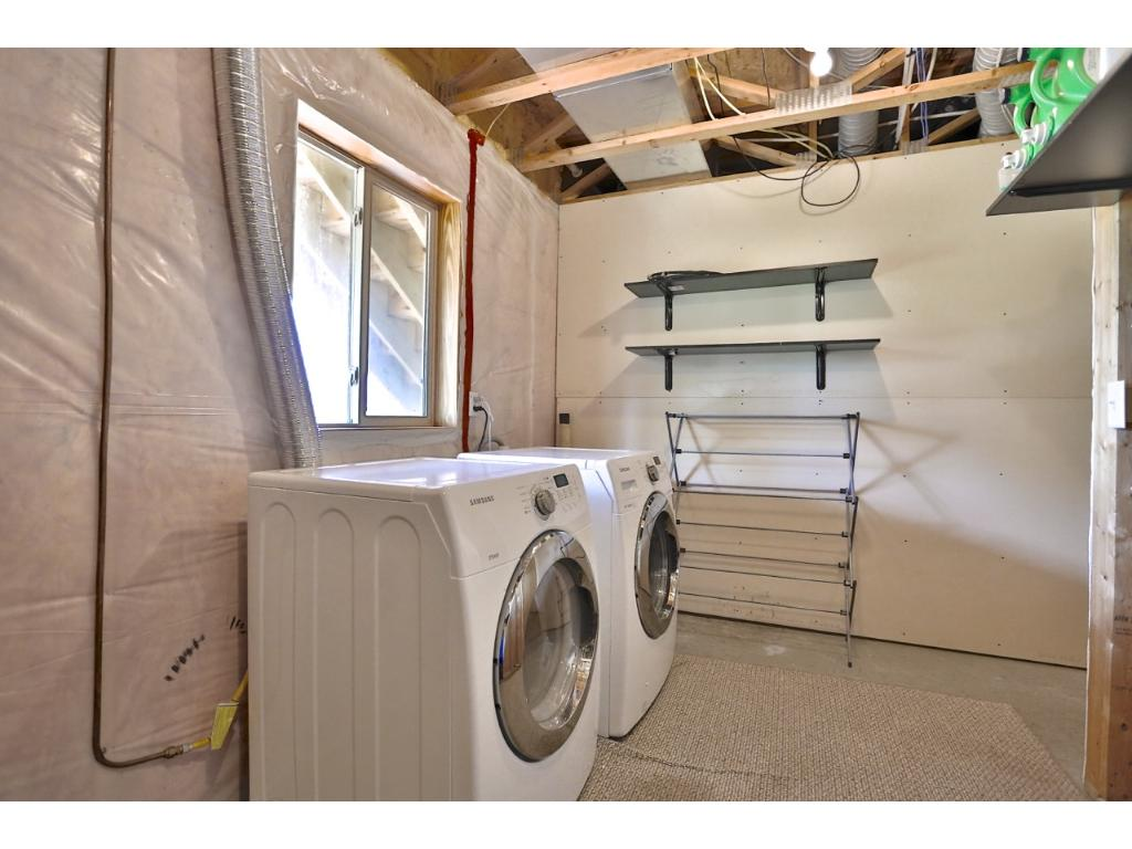 Laundry room with washer and dryer that stay with the property.