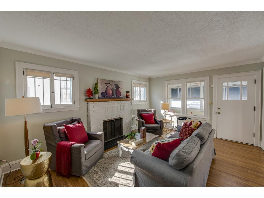 Sunlit Living Room With Beautifully Refinished Hardwood Flooring.