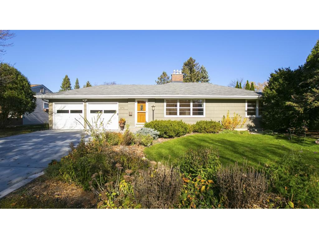 Lovingly landscaped yard, recently painted exterior and lovely, usable back yard.